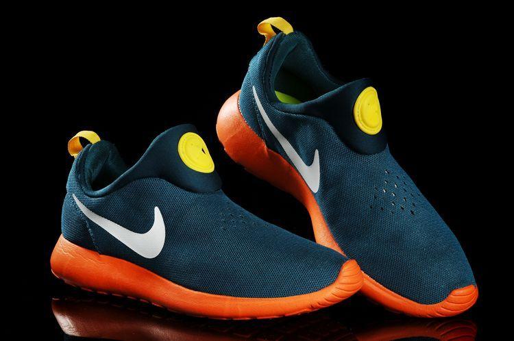 b2d962486bbb Blue Nike Shoe With Orange Swoosh Background Nike Shox Vaeda Size 10 ...